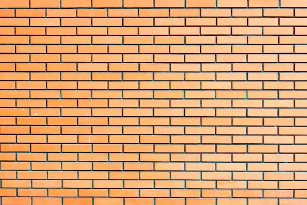 Textura de una pared de ladrillos con grietas y arañazos.