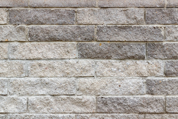 Textura de pared de ladrillos de piedra gris. fondo de ladrillo de piedra abstracta
