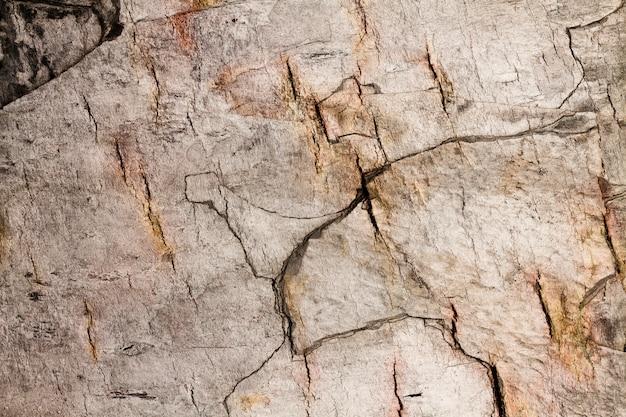 Textura de pared de piedra apilada agrietada