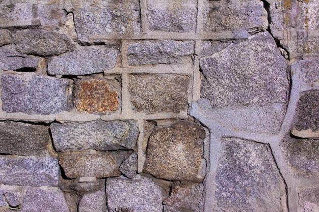 Textura de pared de piedra con juntas de cemento.