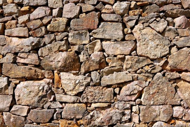Textura de la pared de piedra de mampostería, antigua arquitectura antigua españa detalle