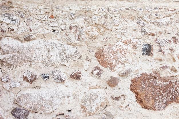 Textura de pared de piedra. pared decorativa de rocas de mosaico