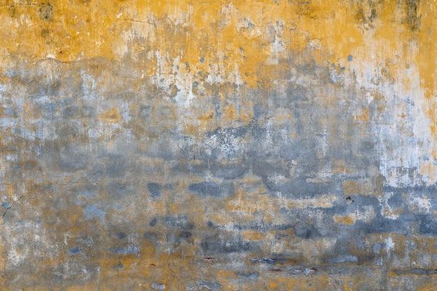 Textura de pared pintada de amarillo viejo