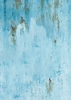 Textura de pared pintada de azul claro con grietas