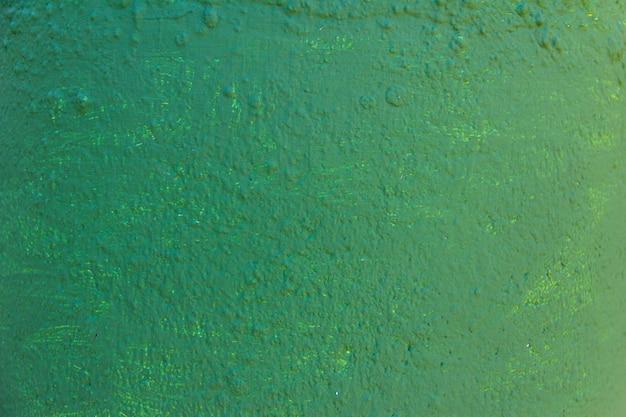 Textura de pared pintada de verde. bandera.