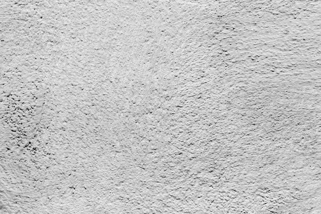 Textura de pared con pintura blanca y grumos. copie el espacio.