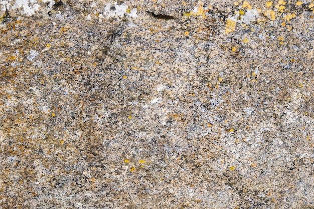 Textura de una piedra de granito con diferentes colores.