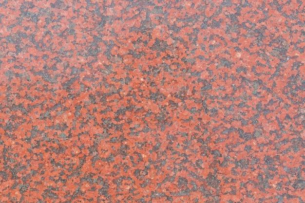 Textura de piedra de granito rojo del uso de la naturaleza para el fondo