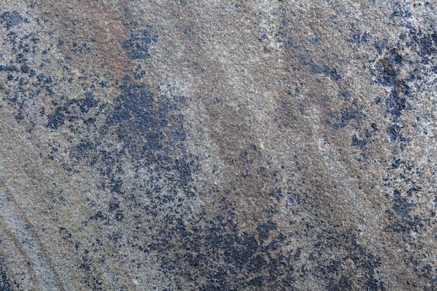 Textura de piedra natural marrón y azul.