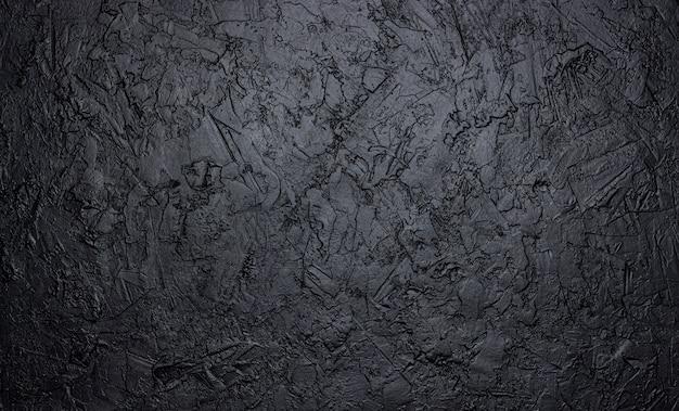 Textura de piedra negra, fondo de pizarra oscura