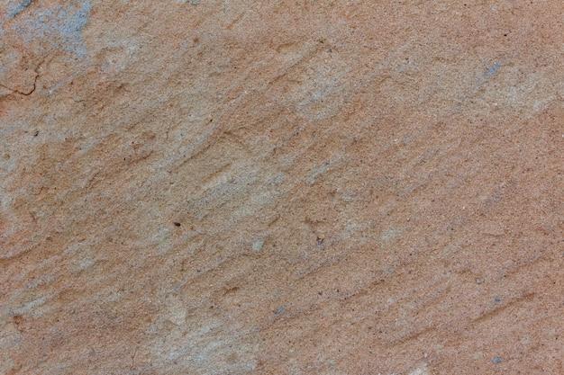 Textura de piedra pulida con detalles naranjas. copie el espacio.