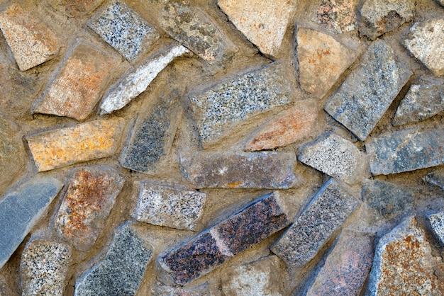Textura de piedras de diferentes colores, ladrillos y hormigón.