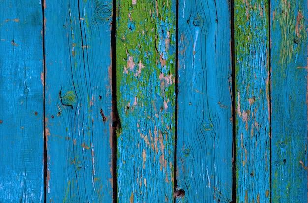 Textura pintada elegante lamentable azul resistida agrietada del tablero de madera, vista delantera