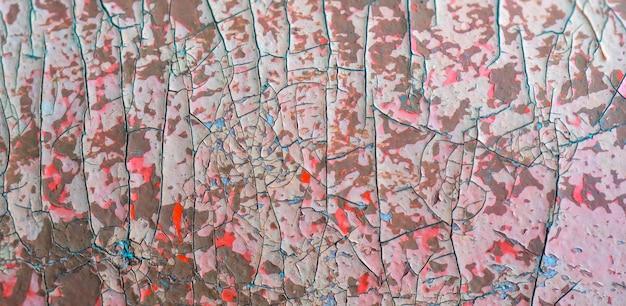 Textura de la pintura agrietada rosada.