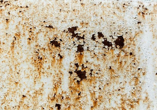 Textura de pintura vieja agrietada en una pared