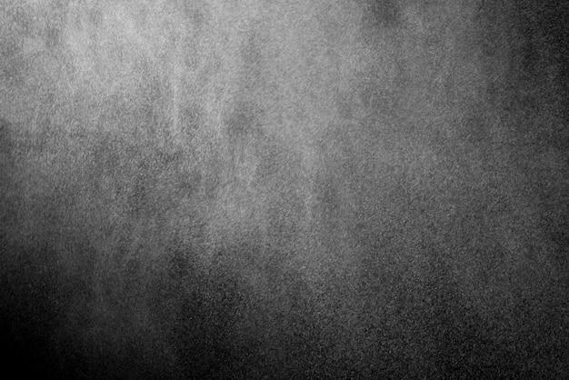 Textura de polvo o nieve sobre fondo negro
