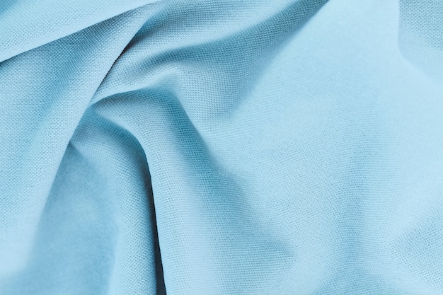 Textura de primer plano tela azul claro de traje