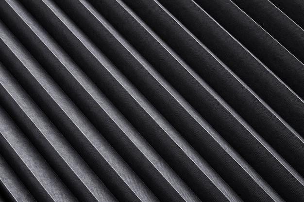 Textura de rayas negras, fondo de metal acanalado