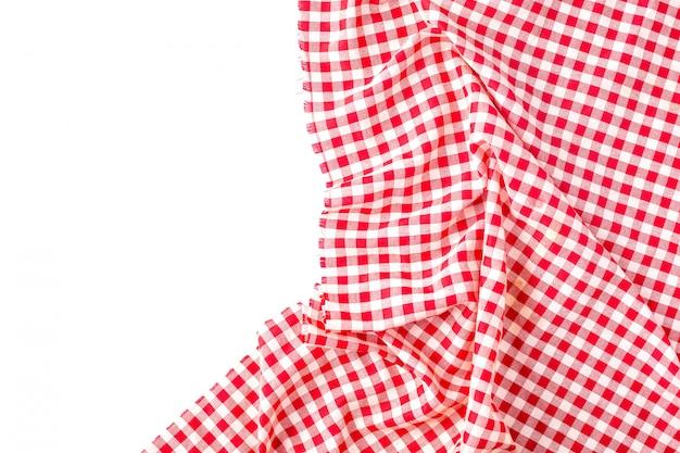 Textura roja del mantel en blanco