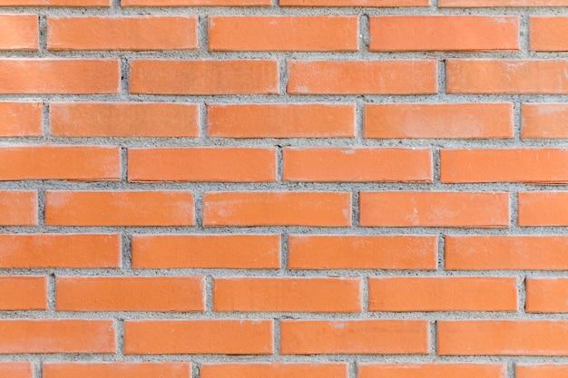 Textura rugosa de la pared de ladrillo al aire libre
