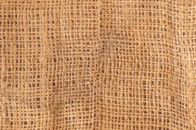 Textura de saco de brown como fondo, cierre para arriba.