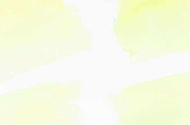 Textura de salpicadura de lavado acuarela amarilla aislada sobre fondo blanco