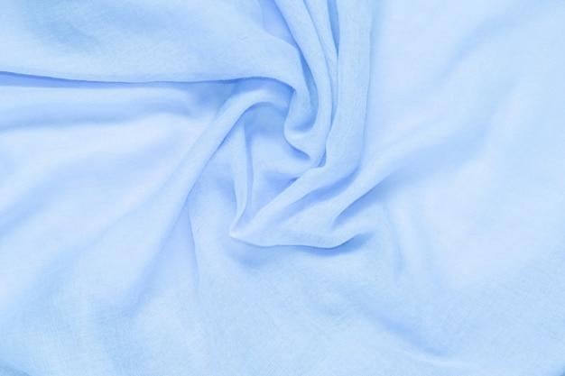Textura suave del fondo del color azul de la tela suave y arrugada