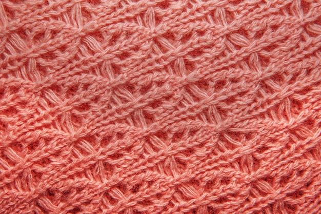 Textura de suéter de lana rosa de cerca