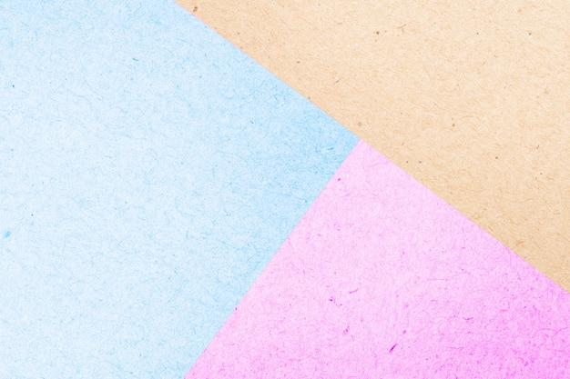 Textura superficial coloreada en colores pastel del extracto de la caja de papel para el fondo