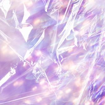 Textura de la superficie plástica de fondo púrpura brillo holográfico