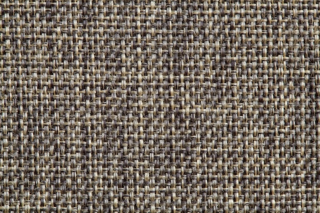 La textura de la superficie de la tela gris oscuro