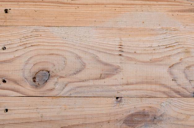 Textura de tablas de madera sin pintar, con textura de madera visible y nudos.