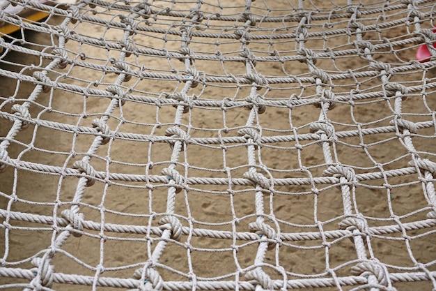 Textura tejida de la cuerda de la red de la subida en patio.