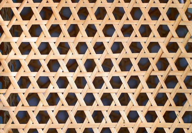 Textura de tejido de bambú, fondo de forma de hexágono de patrón de madera tejida
