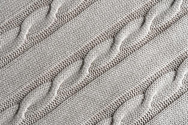 Textura de tejido de punto gris con un patrón