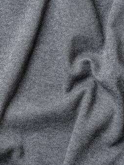 Textura de tela de algodón gris. ropa de jersey de algodón de fondo con pliegues