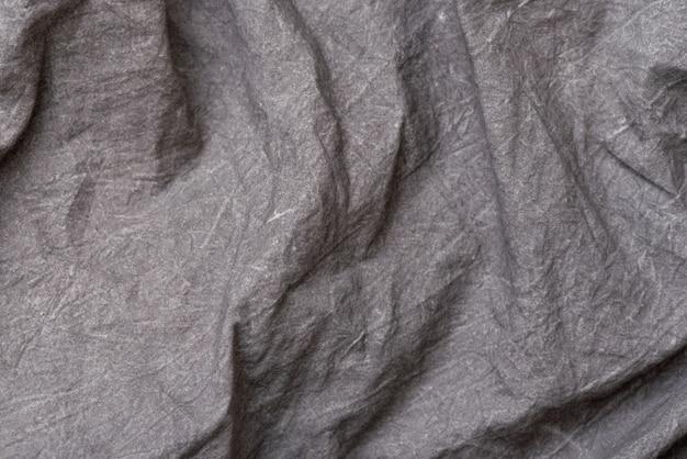 Textura de tela arrugada, fondo de tela gris oscuro. lugar para el texto