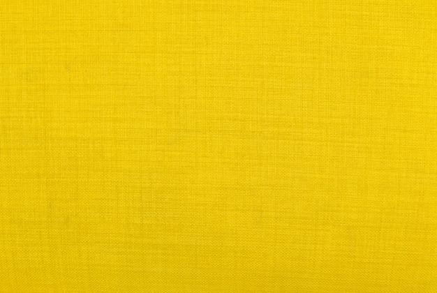 Textura de la tela, close up del fondo amarillo del modelo de la textura de la tela.