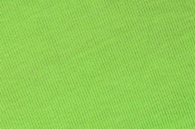 La textura de la tela es verde brillante.