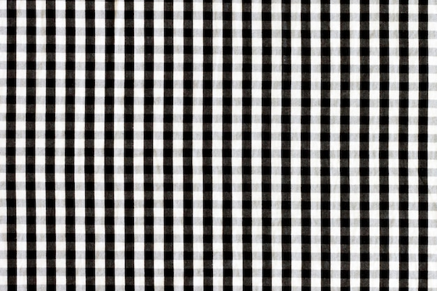 Textura de tela en una jaula. tejido a cuadros en blanco y negro.