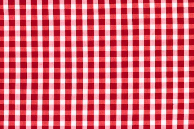 Textura de tela en una jaula. tejido a cuadros rojo y blanco.