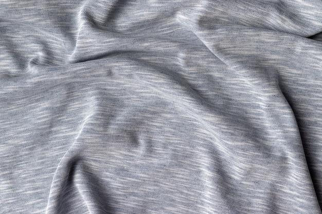 Textura de tela de jersey de algodón. pared textil gris arrugada