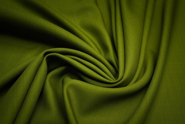 La textura de la tela de lana es de color verde oscuro.