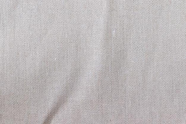 Textura de tela de lino natural. fondo de arpillera arrugada áspera