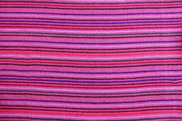 Textura de tela macro rosa vibrante sarape mexicano
