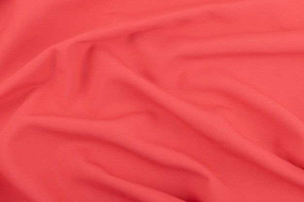 Textura de la tela mate coral roja.