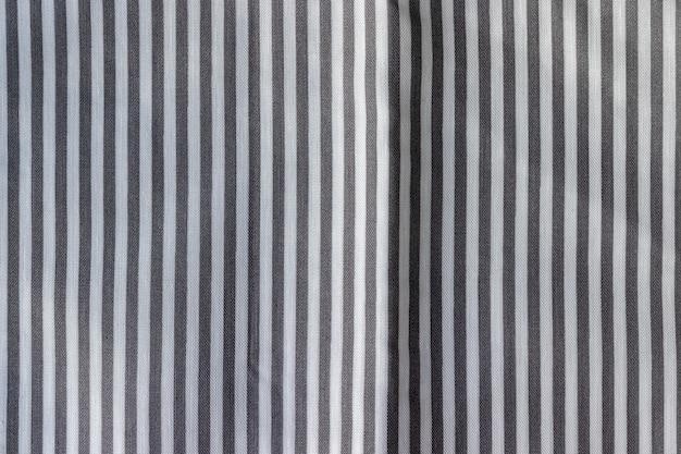 Textura de tela a rayas. pared textil blanca y gris