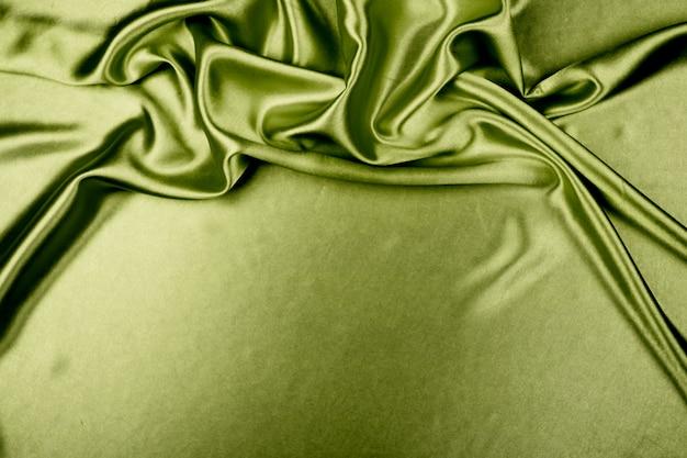 Textura de tela de satén de lujo verde para el fondo