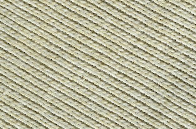 Textura de tela de un suéter de punto amarillo suave.