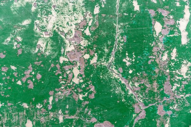 Textura verde de epoxy vieja y abandonada abstracta del piso de la grieta. perfecto para el fondo